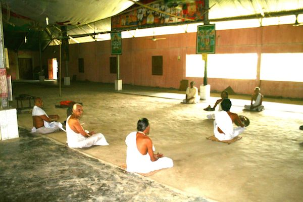 Monk at Satara (Monastery) performing their morning ritual in Majuli Island